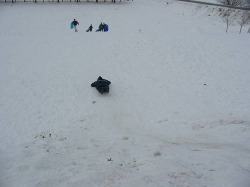 James is sledding down a hill